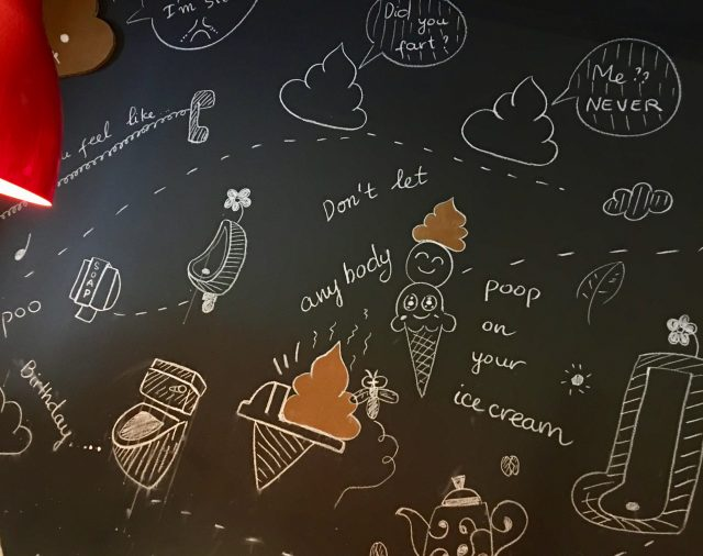 poop cafe wall art drawings chalk board