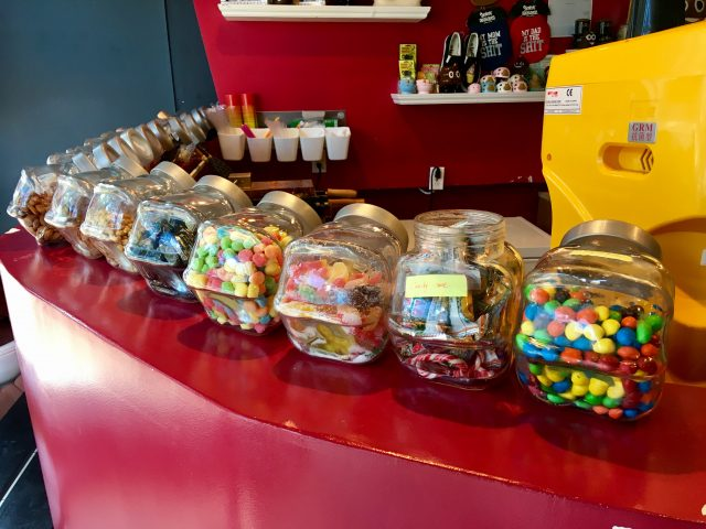 poop cafe toronto display candy jars
