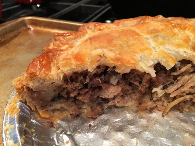 meat filling tourtière pie pork cooked pastry pan delicious